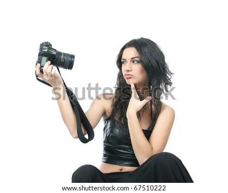 studio shot of young beautiful woman making self-portrait over white - stock photo