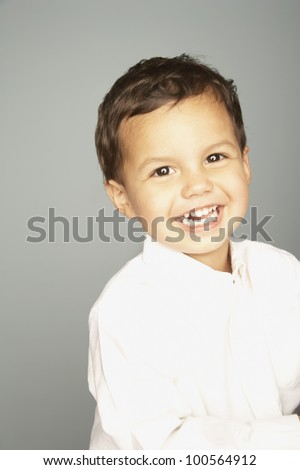 Studio shot of young boy smiling
