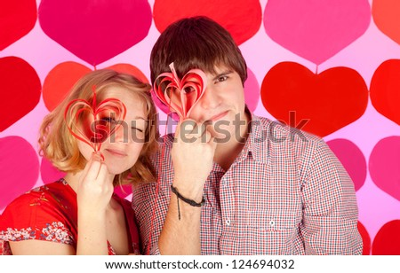 studio shot of young couple in love over colorful background