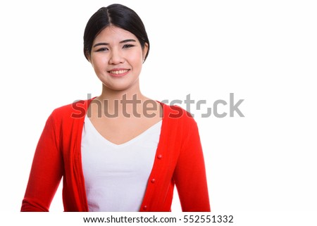 Studio shot of young happy Asian woman smiling isolated against white background