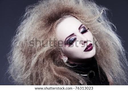 studio shot of young woman, vampire style - stock photo