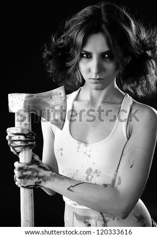studio shot on black background: young woman holding bloody axe (axe girl)