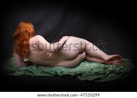 Studio shot overweight woman. Vintage style studio shot. Great for calendar. - stock photo