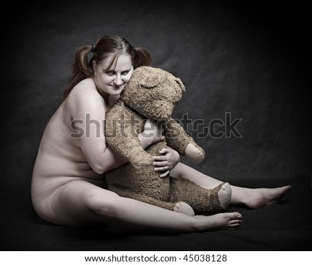 Studio shot overweight woman with old Teddy bear. Great for calendar. - stock photo
