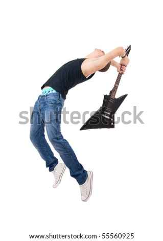studio shot picture on isolated background of a angry man holding a guitar and trying to break it - stock photo