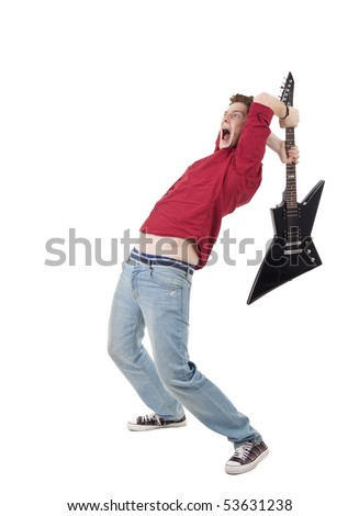 studio shot pictures on isolated background of a angry man holding a guitar and trying to break it - stock photo
