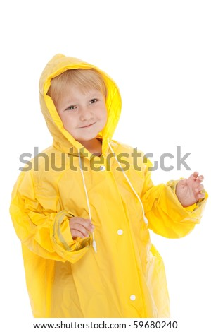 studio shot with child with yellow raincoat - stock photo