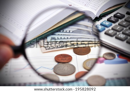 study of cent with a magnifying glass - stock photo