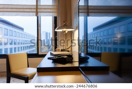 Study room with writing desk armchair and lcd tv set  - stock photo