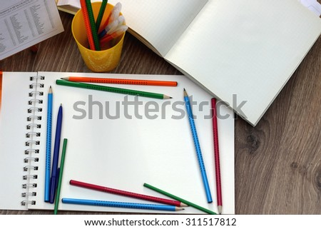 Study table with textbooks and pencils - stock photo