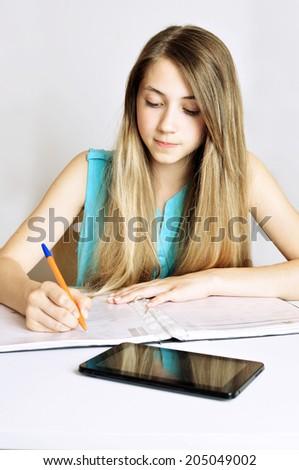 Studying cheerful  teenager girl. Studying cheerful  teenager girl reading her book for school.  - stock photo
