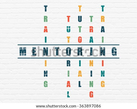 Studying concept: Mentoring in Crossword Puzzle - stock photo