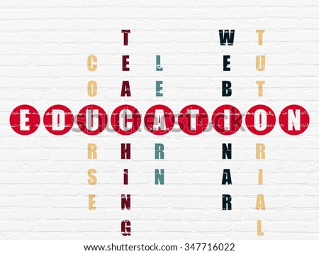 Studying concept: Painted red word Education in solving Crossword Puzzle - stock photo