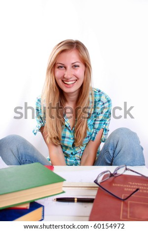Studying happy young woman reading her book for school. - stock photo