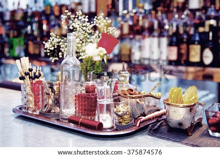 Stuff used for decorating cocktails on bar counter, toned image