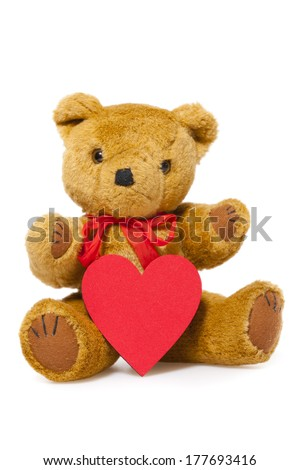 Stuffed animal teddy with a red Heart isolated on white Background with Copy Space on the Heart