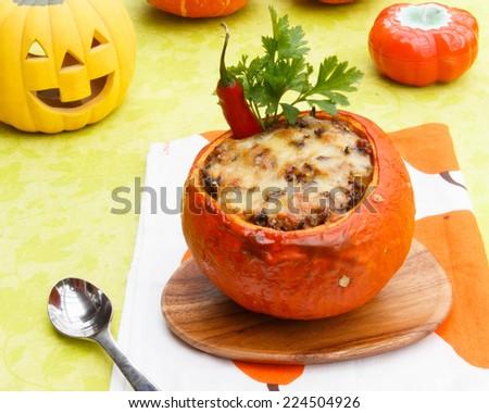 Stuffed baked pumpkin for Halloween day - stock photo