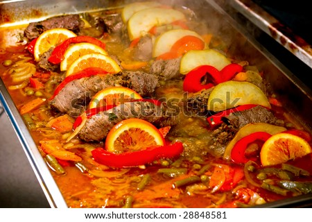 Stuffed beef prepared with fruits and vegetables - stock photo