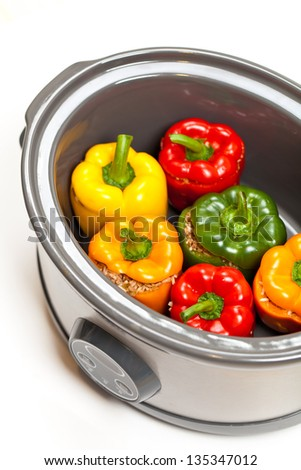 Stuffed Bell Pepper in a slow-cooker, ready to cook - stock photo