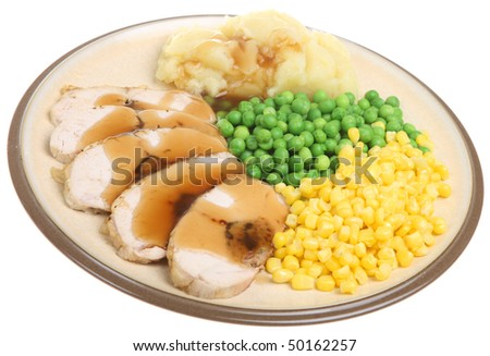 Stuffed breast of chicken served with mashed potato , peas and sweetcorn. - stock photo