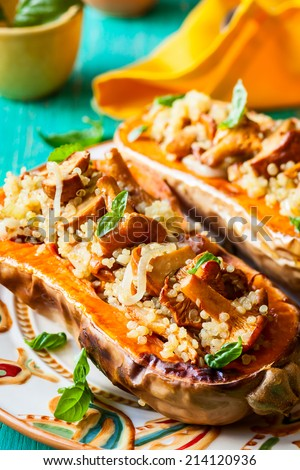 Stuffed butternut squash with quinoa and mushrooms - stock photo