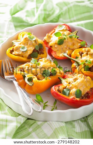 stuffed colorful peppers with meat cheese vegetables - stock photo