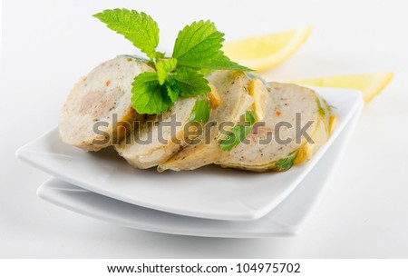 stuffed fish with  on white plate - stock photo