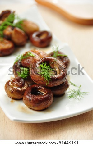 stuffed mushrooms, covered in herbs - stock photo