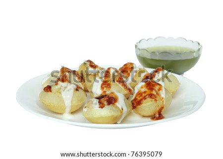Stuffed panipuri with curd and sweet tamarind topping at shallow DOF - stock photo