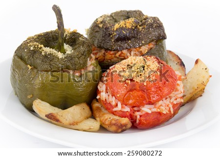 Stuffed pepper and tomato with rice and parmesan cheese over white - stock photo
