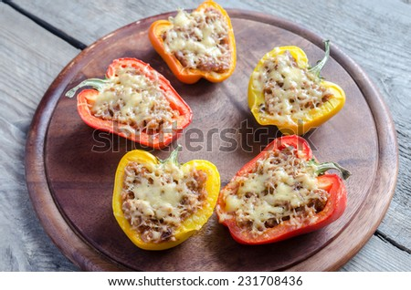 Stuffed peppers with meat in rustic decor - stock photo