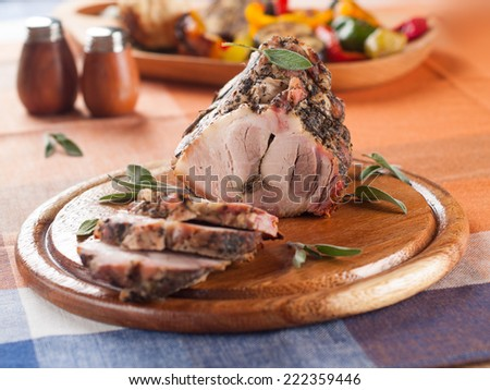 Stuffed pork roll with spices, selective focus - stock photo