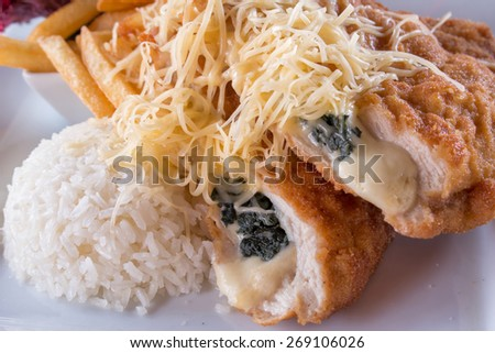 Stuffed schnitzel with french fries and rice,cheese - stock photo