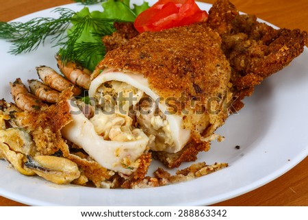 Stuffed squid with seafood - mussels, shrimps, octopus - stock photo