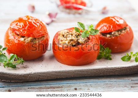 Stuffed tomatoes with meat and vegetables - stock photo