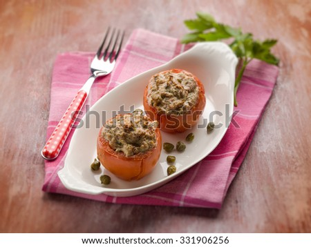 stuffed tomatoes with tuna and capers, selective focus - stock photo