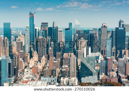 Stunning aerial skyline of Midtown Manhattan on a sunny day, New York City. - stock photo