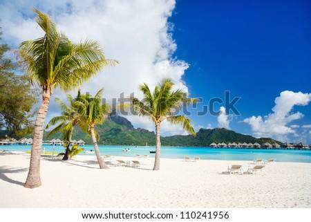 Stunning beach and beautiful view of Otemanu mountain on Bora Bora island - stock photo