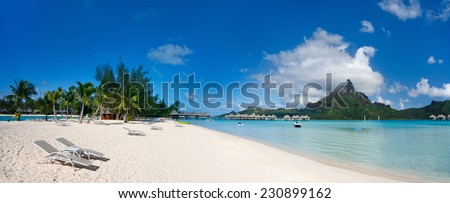 Stunning beach and beautiful view of Otemanu mountain on Bora Bora island - stock photo
