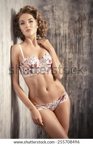 Stunning beautiful young woman alluring in sexual lingerie.  - stock photo