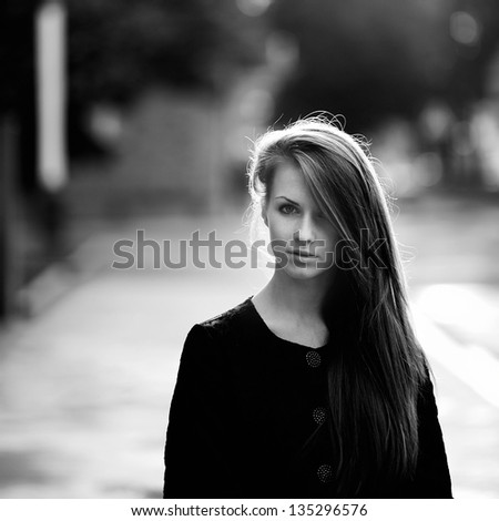 Stunning black and white portrait of a young woman - stock photo