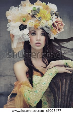 Stunning brunette beauty sitting on a chair - stock photo