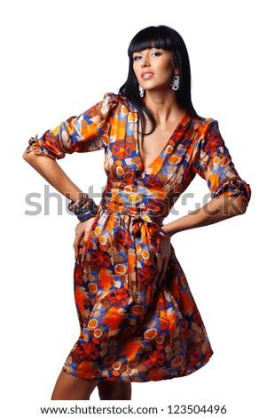 Stunning brunette posing isolated on white background - stock photo