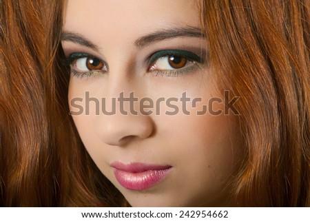 Stunning Female Model With Long Wavy Auburn Hair - stock photo
