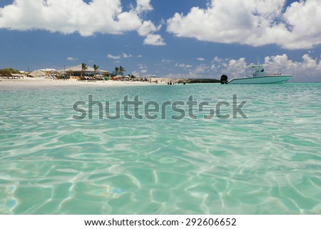 Stunning image of boat sailing away from the beach - stock photo