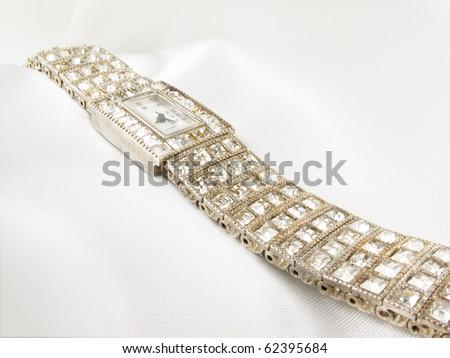 Stunning Ladies Diamond Wrist Watch on white satin - stock photo