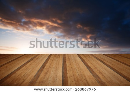 Stunning landscape at sunset over rolling English countryside with wooden planks floor - stock photo