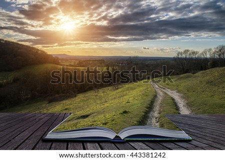 Stunning landscape image of sunset over countryside landscape in England with path continuing on book