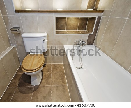stunning luxury bathroom with brown ceramic tiles and wooden shelves with built spotlights - stock photo