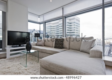 stunning luxury living room with floor to ceiling windows - stock photo